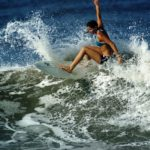 Woman carving a wave in Nicaragua