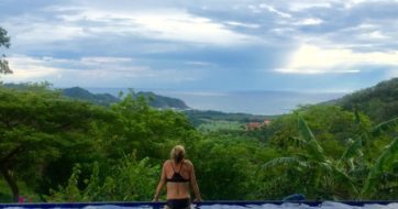 woman hanging by the pool and enjoying her surf retreat in Nicaragua